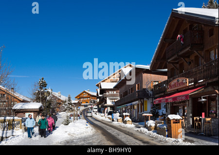 Shops and bars on a street in the centre of Meribel, Three Valleys, Tarentaise, Savoie, France - Stock Photo