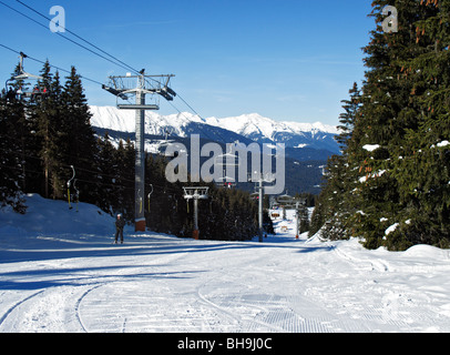 Chair and button lifts on the beginners slopes in the Altiport ski area of Meribel, Three Valleys, Tarentaise, Savoie, - Stock Photo