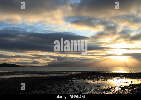 Sunset over the Isle of Skye from Applecross Bay - Stock Photo