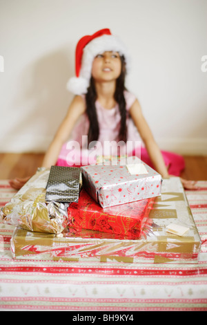 Six year old girl with santa hat - Stock Photo