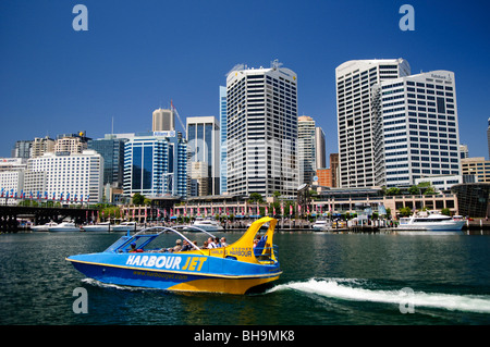 SYDNEY, Australia - SYDNEY, Australia - A tourist jet boat heading out from Darling Harbour in Cockle Bay with the - Stock Photo