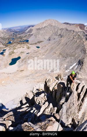 Climber on the northeast ridge of Bear Creek Spire, John Muir Wilderness, Sierra Nevada Mountains, California - Stock Photo