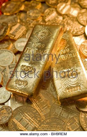 Zwei Goldbarren auf Münzen - two Gold Bars on Gold Coins - Stock Photo