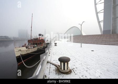 The Waverley Paddle Steamer berthed at a snowy Pacific Quay on the River Clyde Glasgow Scotland UK - Stock Photo