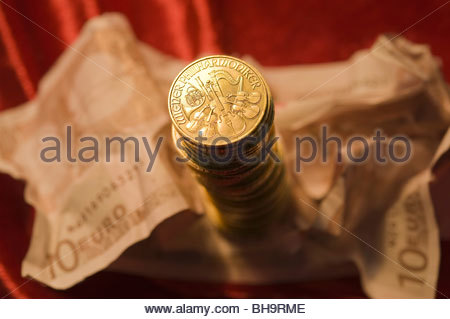 Gold und Papiergeld - Gold Coins and Euro Banknotes - Stock Photo