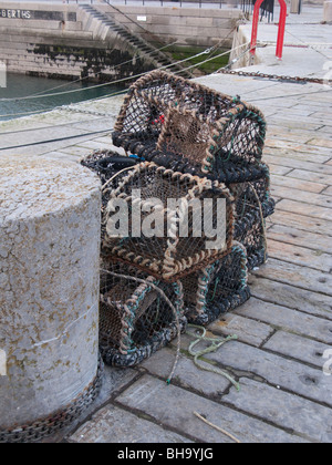 Lobster pots on harbour side, Donaghadee, Northern Ireland, UK - Stock Photo