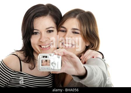 Two beautiful young woman taking self portraits - Stock Photo