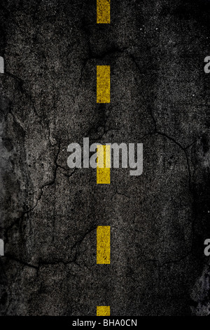 Asphalt background texture with a divided yellow line - Stock Photo