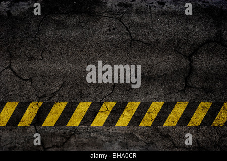 Asphalt background texture with construction signs - Stock Photo