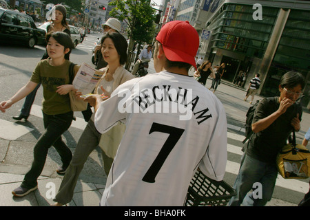 Fan wearing Manchester Utd football shirt, in Tokyo, Japan. - Stock Photo