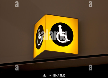 Disabled toilet sign, Terminal 5, Heathrow airport, London, England - Stock Photo