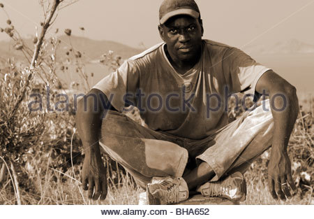 Izza a 31 year old migrant worker from Senegal Africa poses in Greece. MIGRANT WORKER EUROPE MIGRANTS Boat people - Stock Photo