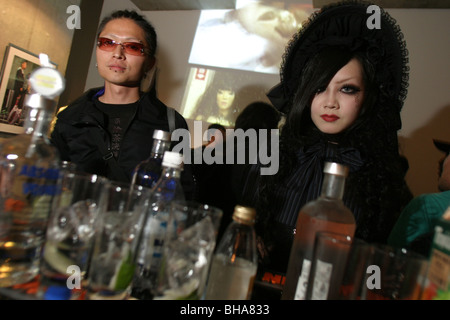 Cosplay and unique fashions on show at exhibition of photos (by Nadev Kander for 'Absolut' vodka) opening party, - Stock Photo