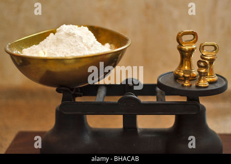 Flour on a weigh scale - Stock Photo