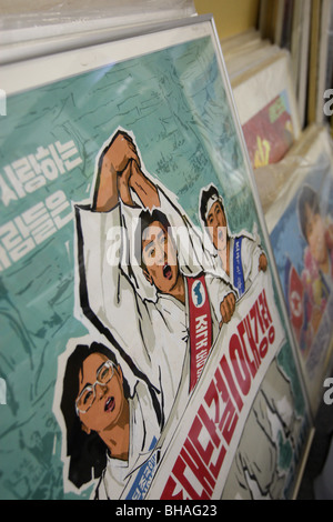 Rainbow Trading Company ( a North Korean speciality bookstore) shows the North Korean posters they have for sale. - Stock Photo