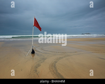 Unsafe bathing flag, Gwithian Towans, Cornwall, UK - Stock Photo