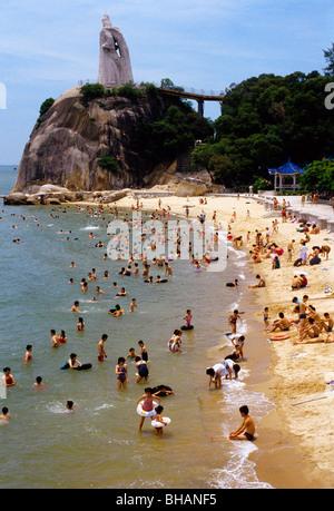 Beach in on Xiamen's Gulangyu Island with granite statue of the Ming dynasty national hero Zheng Chenggong (Koxinga) - Stock Photo