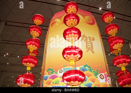 A large Chinese lantern with small lanterns around it in Beijing Airport. - Stock Photo
