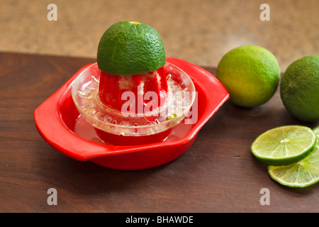 Squeezing limes for juice - Stock Photo