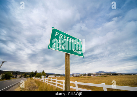 Town Sign Freedom Wyoming Idaho border town. Population 100. Elevation 5900 - Stock Photo