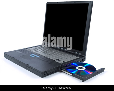 A black laptop with dvd in tray. Isolated over white background. - Stock Photo