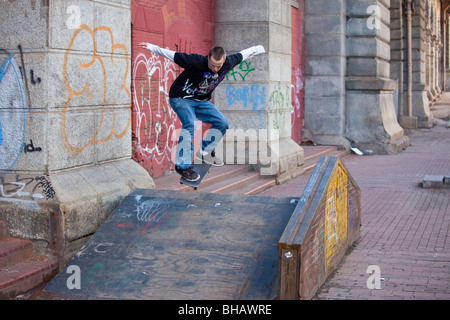 Teen doing skateboard tricks in Manhattan, New York City - Stock Photo