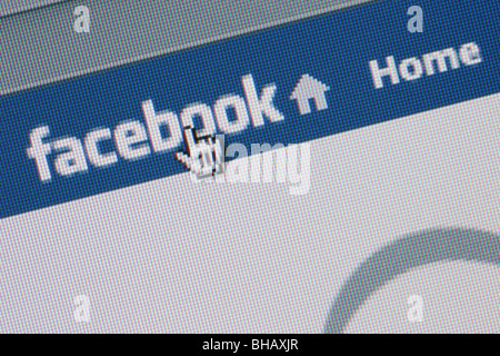 Close-up screenshot of Facebook social networking website logo on home page with cursor pointing. England UK Britain - Stock Photo