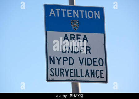 Area Under NYPD Video Surveillance street sign in New York City - Stock Photo