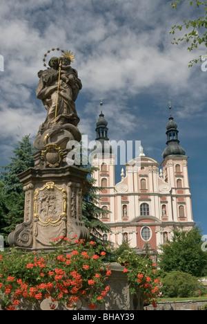 Holy Mary with Jesus statue at Rynek and Saint Nicholas Church in Otmuchów, Opolskie, Poland - Stock Photo