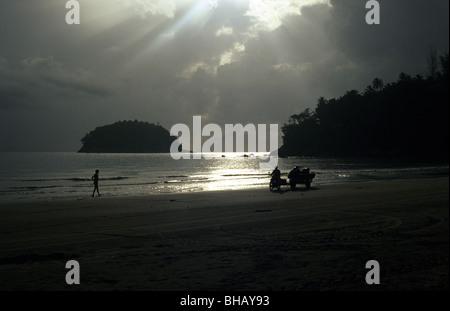 Sunsetting on Karon Beach in Phuket, Thailand - Stock Photo