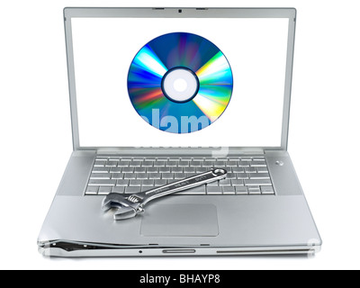 Damaged laptop with a spanner over it and a digital disc on the screen. Isolated on white. - Stock Photo