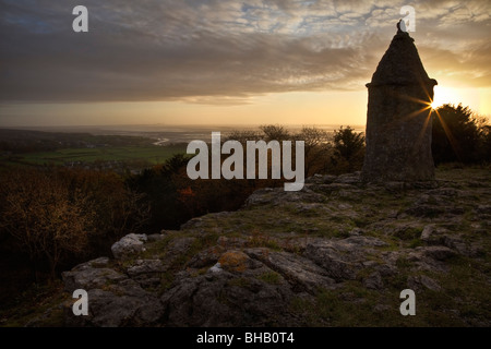 The Pepperpot with sun setting over Morecambe Bay, Eaves Wood, Silverdale, Lancashire