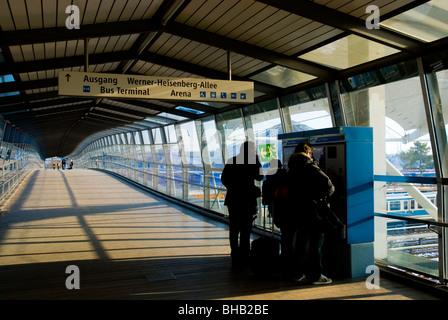 Germany, Bavaria, Munich, Person at ticket machine in ...
