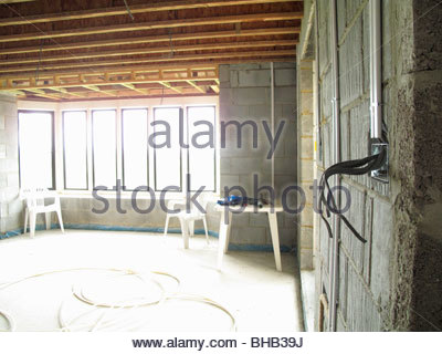 Exposed electrical wires in house under construction - Stock Photo