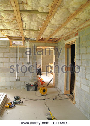 Insulation and tools in house under construction - Stock Photo