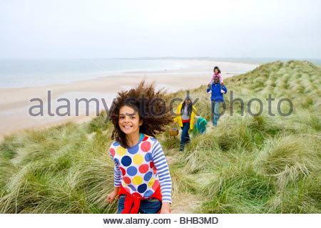 Family walking on beach path - Stock Photo