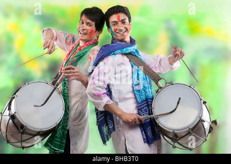 Two men playing on dhols - Stock Photo