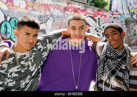 Teenage gang against graffiti wall - Stock Photo