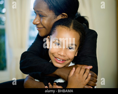 A mother hugging her little girl - Stock Photo