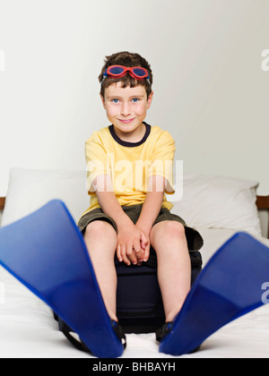 A boy wearing goggles and flippers - Stock Photo