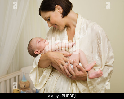 A mother holding a new born baby - Stock Photo