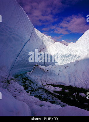 A unique photo from inside a crevasse on the Matanuska Glacier in Alaska where we can see how the glacier is melting - Stock Photo