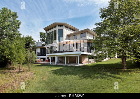Rear view of suburban home with large deck - Stock Photo