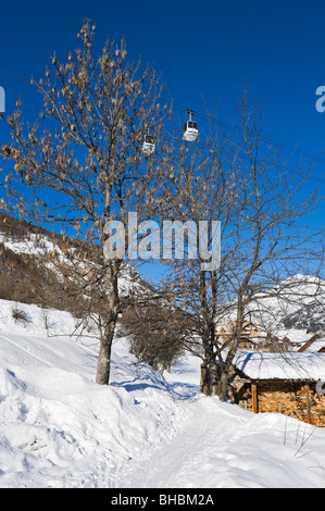 Path above the village of Le Bez with gondolas above, La-Salle-Les-Alpes, Serre Chevalier, Hautes Alpes, France - Stock Photo