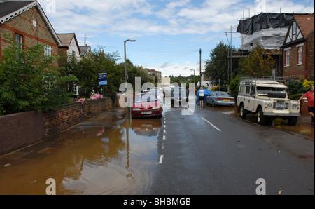 Suburban street as flood recedes - Stock Photo