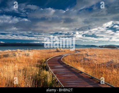 Wooden walkway to Mono Lake, California. - Stock Photo