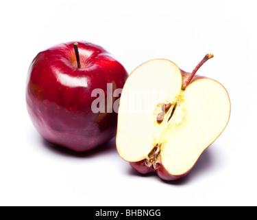 Red apples whole and halved - Stock Photo