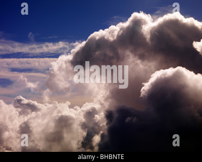 Clouds over Alaska, an aerial view of the clouds. Weather and clouds as seen from a pilots perspective and view - Stock Photo