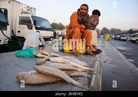Fishermen at Dubai Fishmarket, United Arab Emirates - Stock Photo