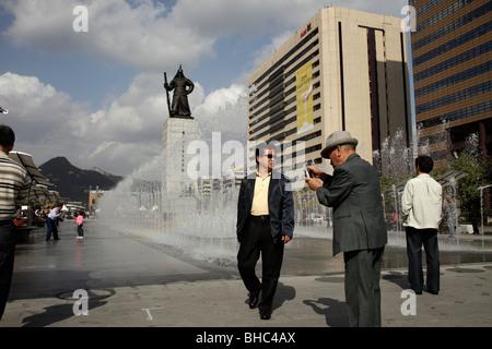 fountain in front of the Admiral Yi Sun Shin Statue at Gwanghwamun plaza in downtown Seoul, South Korea, Asia - Stock Photo